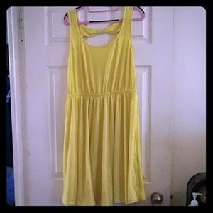 Bright yellow sun dress with bow back accent